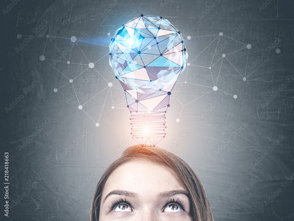 Fototapety, obrazy: Young woman looking at light bulb on blackboard