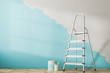 Leinwandbild Motiv Half painted blue wall, ladder