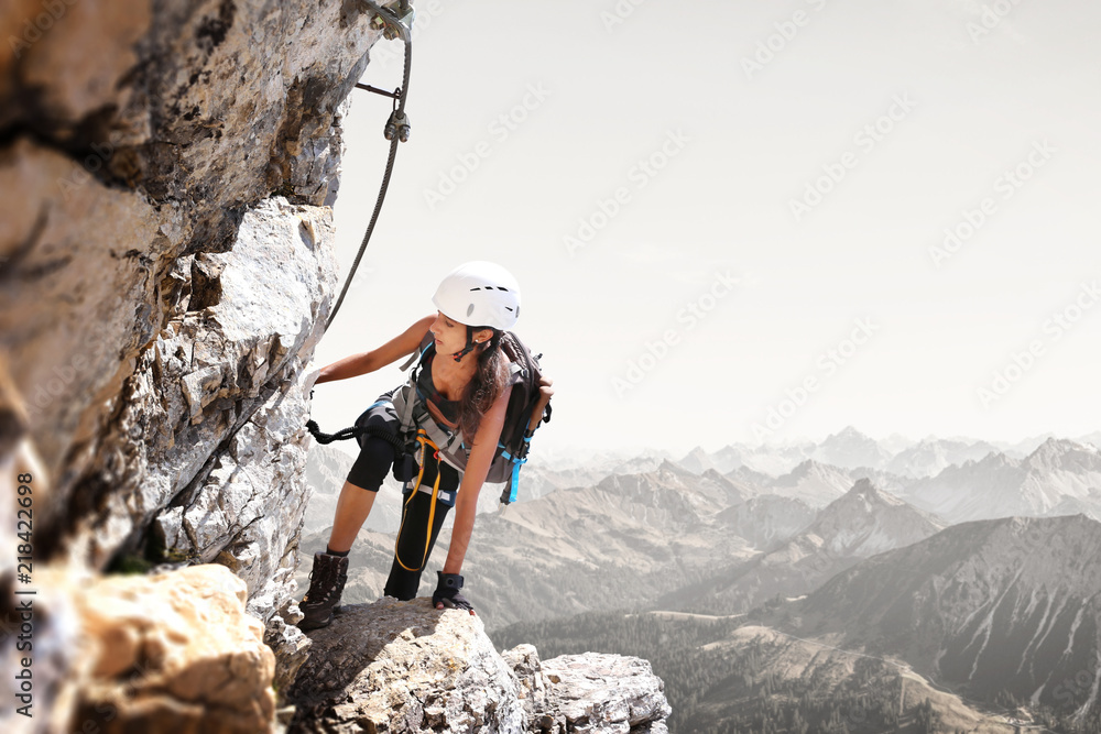 Fototapety, obrazy: Fit sporty young woman mountain climbing