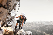 Fit Sporty Young Woman Mountain Climbing