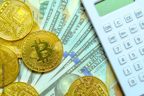 Golden Bitcoin Replica With Calculator On Dollar Bills Or Bank Notes
