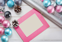 Pink And Blue Christmas Balls And Wrapping Paper For Gifts With Old Photo Frame