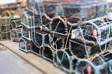 Stacked Lobster Fishing Pots Netted Boxes At Harbour Wall