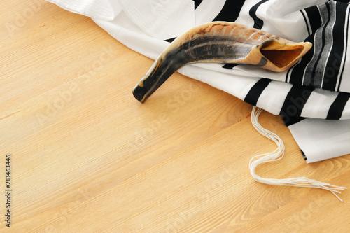 shofar (horn) on white prayer talit. rosh hashanah (jewish holiday) concept. Rosh hashanah (jewish New Year holiday), Shabbat and Yom kippur concept.