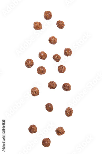 Stickers pour porte Graine, aromate Chocolate cereal balls falling isolated on white background.
