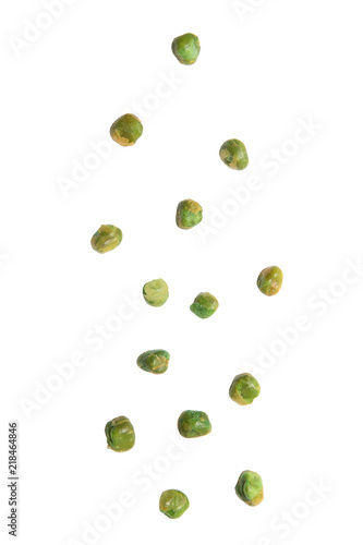 Green peas with salt falling isolated on white background.