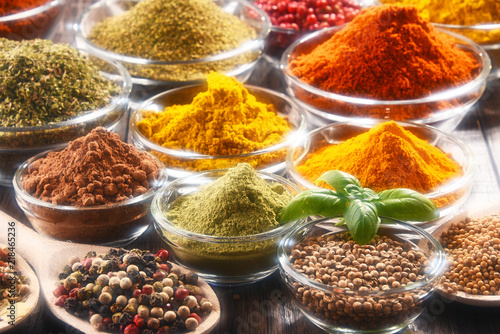 Wall Murals Spices Variety of spices and herbs on kitchen table