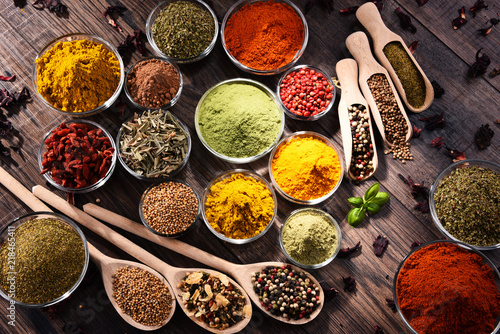 Foto op Plexiglas Kruiden Variety of spices and herbs on kitchen table