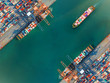Leinwandbild Motiv container port terminal keep busy and congestion by the ships vessels are working operation in transfer cantainers cargo shipment, transport and logistics services to global Worldwide
