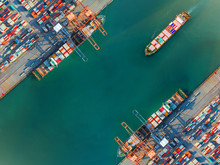 Container Port Terminal Keep Busy And Congestion By The Ships Vessels Are Working Operation In Transfer Cantainers Cargo Shipment, Transport And Logistics Services To Global Worldwide