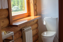 Toilet In A Rustic Log House