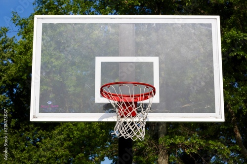 A glass backboard on the outdoors basketball hoop. Canvas Print
