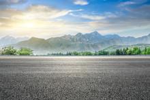 Empty Asphalt Highway And Gree...