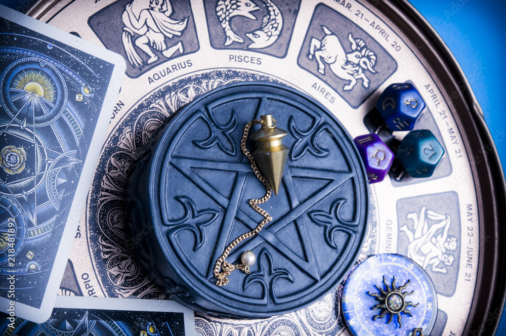 Fototapeta horoscope with zodiac signs, astrology dice, pendulum, pentagram and cars like esoteric concept