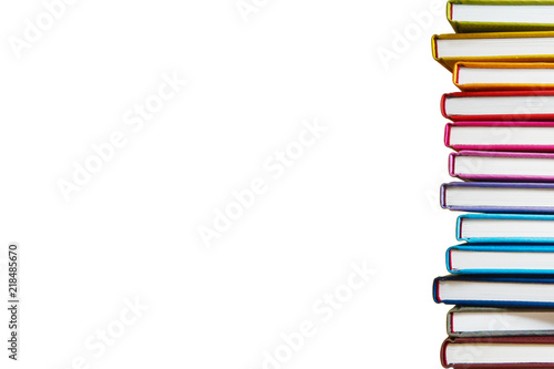 Fototapeta Books. A lot of books with bright covers in one pile isolated on white background. Place for text. Design element, paper and leather texture. Colorful books on the shelf, close up obraz