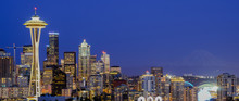 Panoramic Beautiful Seattle Illuminated Skylines Downtown During Blue Hour, View From Kerry Park At Queen Anne Hill. Mount Rainer Can Be Seen From Background.