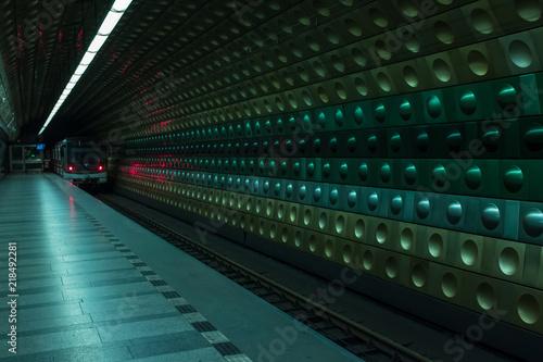 A train departs the platform at  Metro Station in Prague, Czech Republic