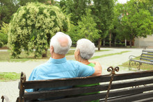 Elderly Couple Resting On Benc...