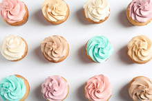 Flat Lay Composition With Delicious Birthday Cupcakes On White Background