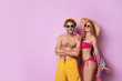Happy young couple in beachwear on color background. Space for text