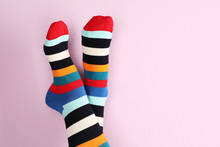 Woman Wearing Stylish Socks And Space For Design On Color Background