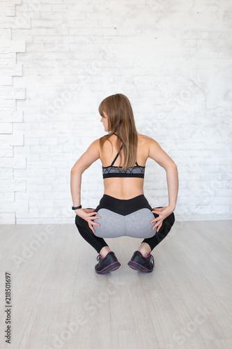 Fotografie, Obraz  Rear view of sportive woman wearing sexy leggings