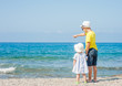 Boy and baby girl on the beach on summer holidays. concept of summer family vacation. Space for text