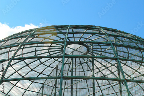 Vászonkép Metal large aviary for birds in the form of a dome