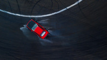 Aerial Top View Professional Driver Drifting Red Car On Wet Asphalt Race Track With Water Splash, Auto Or Automobile Background Concept.