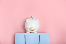 Flat Lay Composition With Shopping Bag And Piggy Bank On Color Background