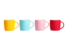 Different Colorful Cups On Whi...
