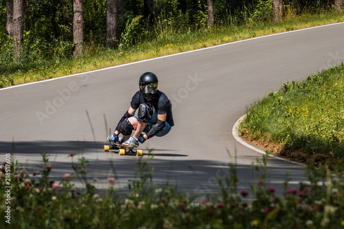 Longboard downhill rider make fast in a turn Wallpaper Mural