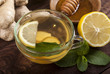 Ginger tea with lemon, mint and honey on wooden background