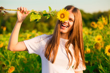 Happy Joyful Girl With Sunflow...