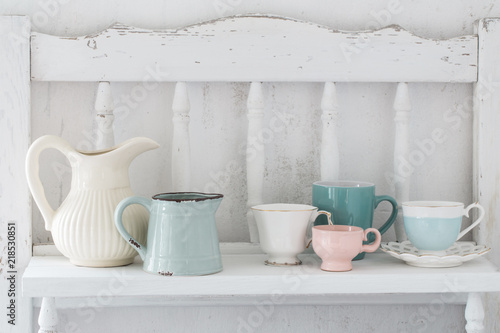 Obraz  dinnerware on white wooden shelf - fototapety do salonu