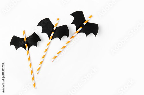 Striped straws with paper bats on white background Wallpaper Mural