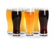Glasses with different beer on white background