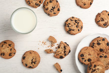 Flat Lay Composition With Chocolate Cookies And Glass Of Milk On Light Background
