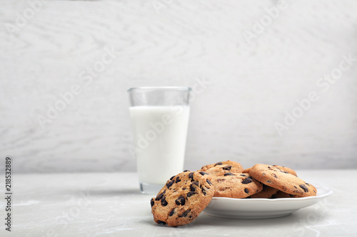 Plate with tasty chocolate cookies on gray table Canvas Print