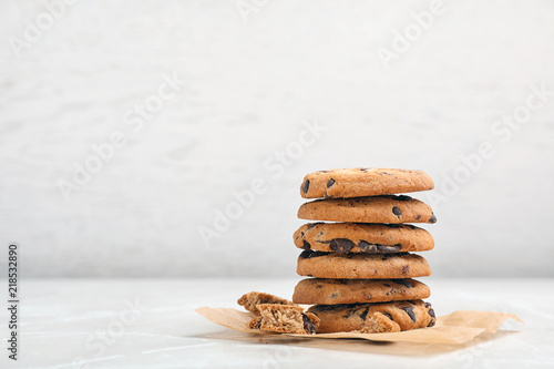 Stack of tasty chocolate cookies on light table