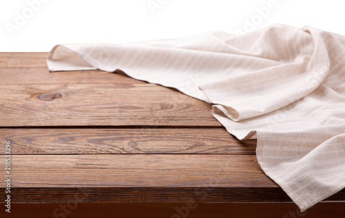Tablecloth on wooden table isolated. Canvas, dish towels on kitchen top view mock up. Selective focus.