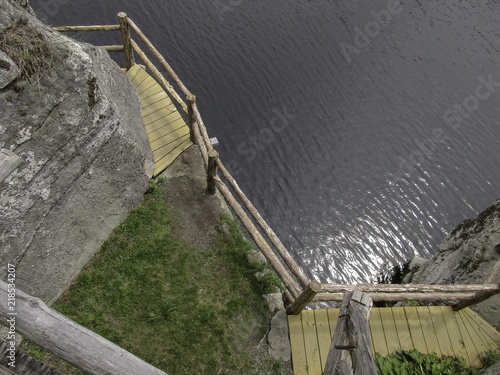Fotografie, Obraz  Rustic precarious wooden trail along a mountain lake