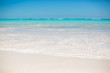 Sea water and blue sky with white sand. Horizon line in Dominican
