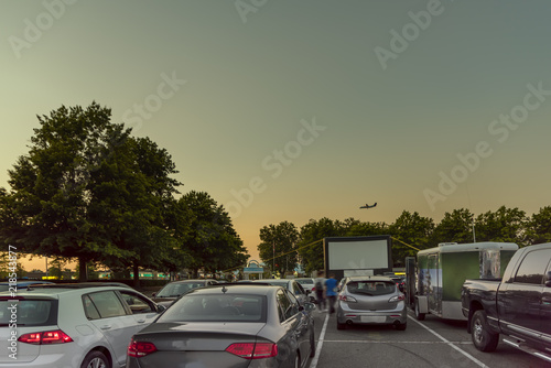 Foto op Plexiglas Motorsport city parking with an inflatable screen of a summer cinema, waiting for a movie