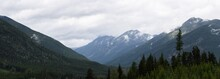 Heavy Rain Moves Across A Dramatic Valley In The Canadian Wilderness