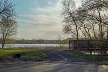 Trail And Bridge Overlooking Lake At Purgatory Creek Park In Eden Prairie, Minnesota