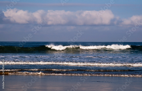 Fototapeten Natur Waves crashing along the shore in southern California, USA from the Pacific ocean on a beautiful morning in summer