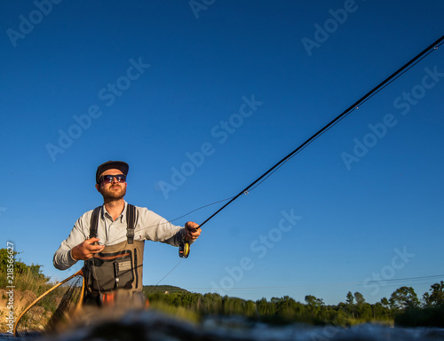 Printed kitchen splashbacks Fishing Over underwater shot of a man fly fishing in the summer in a river