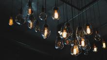 Beautiful Vintage Luxury Light Bulb Hanging Decor Glowing In Dark. Retro Filter Effect Style.