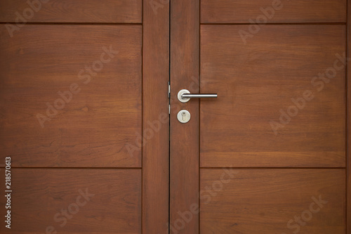 old wood door close with silver handle Canvas Print